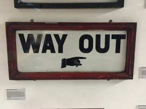 1907 Way out sign with finger motif, this predates the Johnston typeface